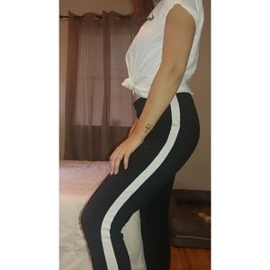 Black leggings with single white stripe